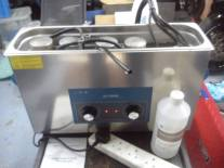 Ultrasonic cleaner with a bank of 4 motorbike carburettors