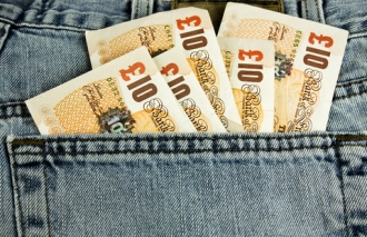 image of ten pound notes in a jeans back pocket